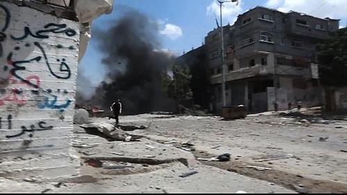 Massacre in Shuja'iyya 20.07.2014.mp4 snapshot 00.02 by moigovps. Licensed under Creative Commons Attribution 3.0 via Wikimedia Commons.